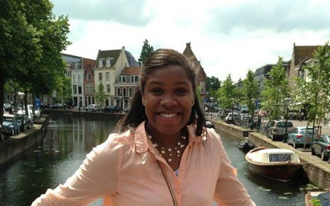 Tia Paulette poses in front of a river in Leiden, Holland.