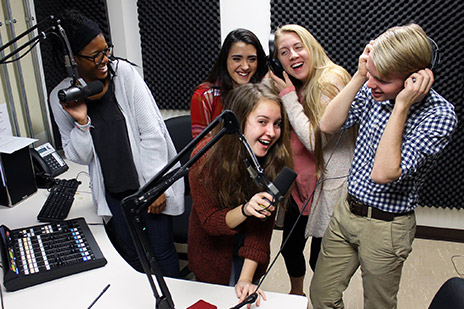 Student journalists in a recording studio.