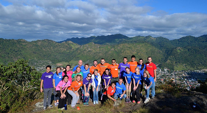 Group of volunteers in front of a mountain vista