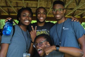 Four Mizzou students pose for a photo