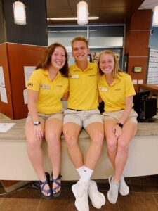 Three Summer Welcome leaders pose for a photo.