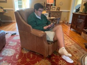 Grayson Rainey works on his laptop in his family living room in Richmond, Virginia.