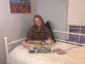 Zoe Rich works on her laptop in her bedroom in St. Louis.