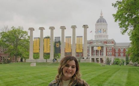 Karlee Resler-Seek stands in front of the Columns on Francis Quadrangle at the University of Missouri.