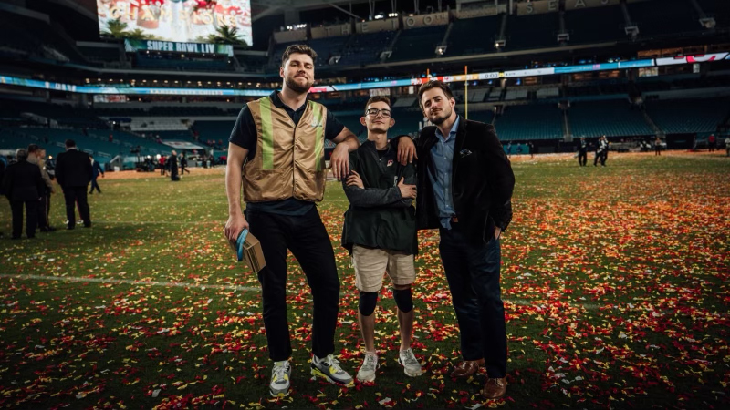 Left to right: Alumni Bryndon Minter, student Diego Galicia and NFL social media co-worker Benji Gallagher pose after the Chief's 2020 Super Bowl win. Note: This photo was taken prior to COVID-19.