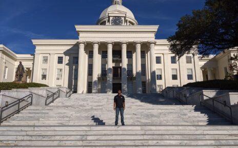 Aravind Kalathil standing on steps of building