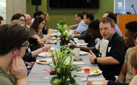Students and faculty socialize during MU's ASH Scholars Breakfast event.