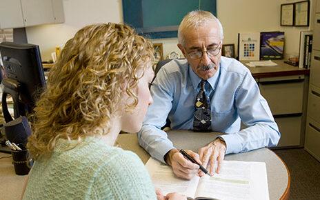 Loren Nikolai works with a student.